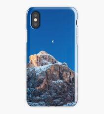 the moon is shining behind a peak iPhone Case/Skin