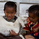 Nepali children with pet kid by John Spies