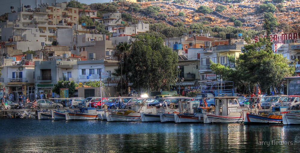The picturesque harbour of Elounda by larry flewers