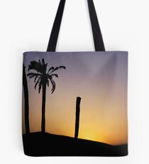 Silhouetted palm trees at sunset in the Sahara Desert Tote Bag