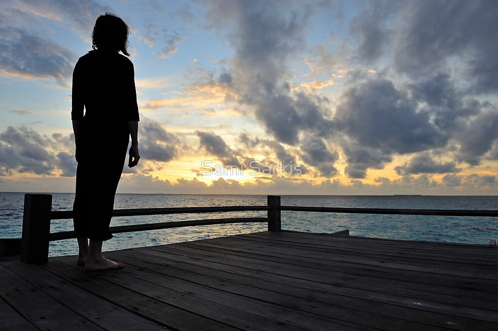 Silhouette of a woman contemplating the sunrise by Sami Sarkis