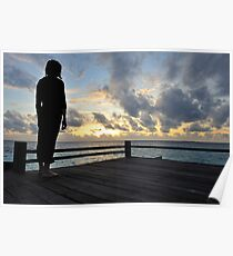 Silhouette of a woman contemplating the sunrise Poster