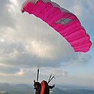 Man paragliding off hill by Sami Sarkis