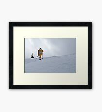 Woman snowshoeing, French Alps, France Framed Print