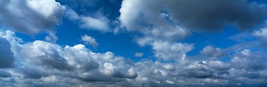 Blue sky with cumulus clouds by intensivelight