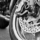 Motorcycle wheel. Beaverton, Oregon. by Christina Weber