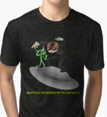 muffled fbi noises in hte distance Tri-blend T-Shirt