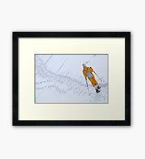 Woman snowshoeing Framed Print