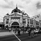 Keeping up - Flinders Street Railway Station by Norman Repacholi