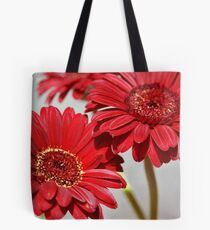 Three red Gerberas Tote Bag