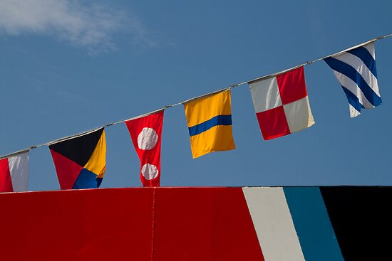 Photo of brightly colored maritime flags by crazylemur