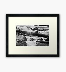 Twigs, water and rocks Framed Print