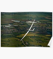 Glider soaring low . Poster