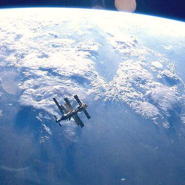 ISS Floating over the Earth by Weedlogger