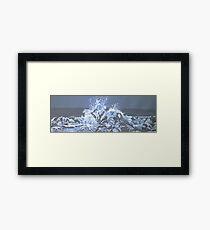waves bursting onto rocks Framed Print
