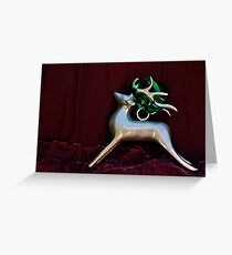 Christmas:  Silver Reindeer Floating on a Deep Red Tree Skirt Greeting Card