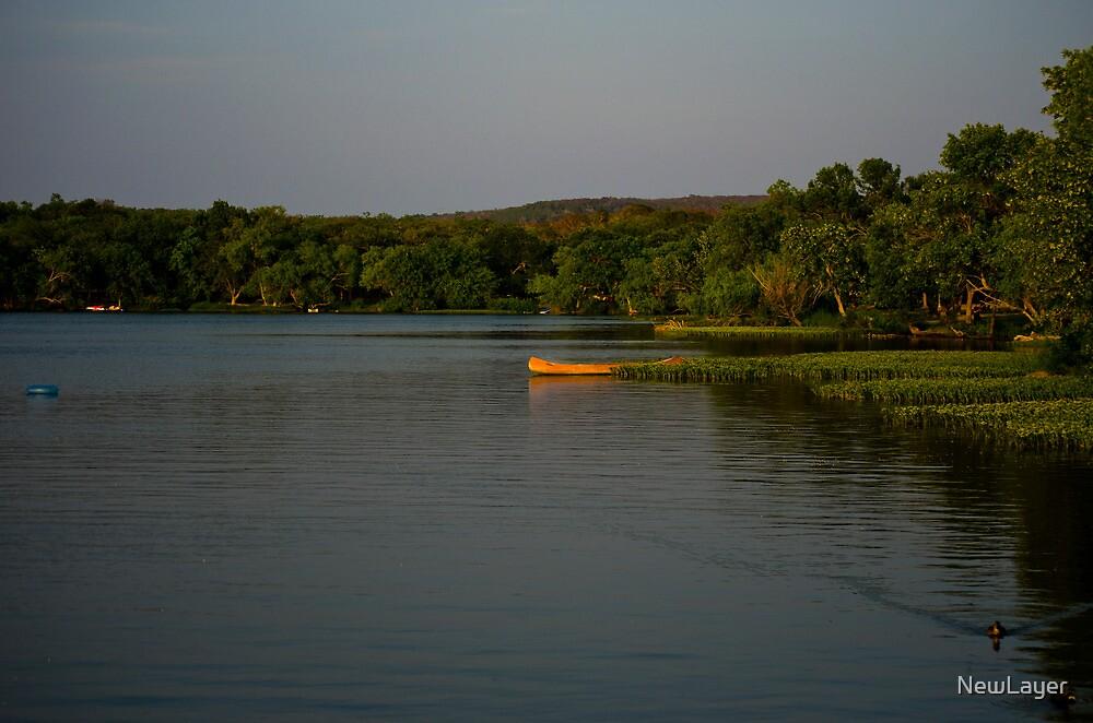 Canoe on lake by NewLayer