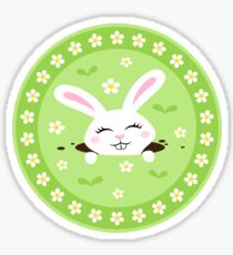 Cute, white bunny rabbit peaking out of a hole in the ground sticker and tote bag Sticker