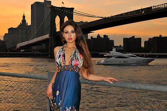 Beautiful girl posing at sunset time under Brooklyn Bridge, NYC by Anton Oparin