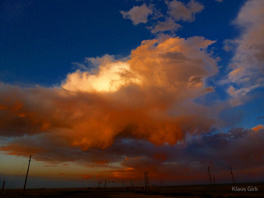 Crazy colored clouds at sunset by Klaus Girk