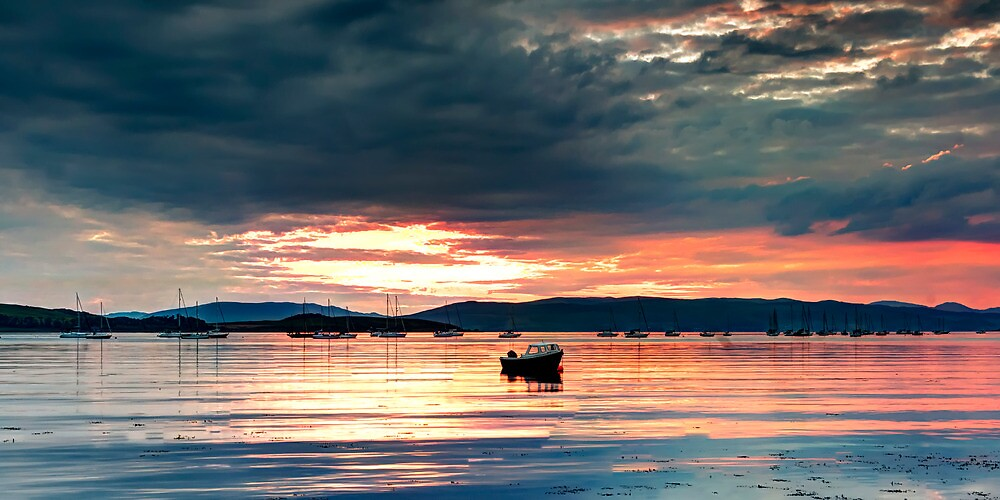 Boats at sunset by Sam Smith