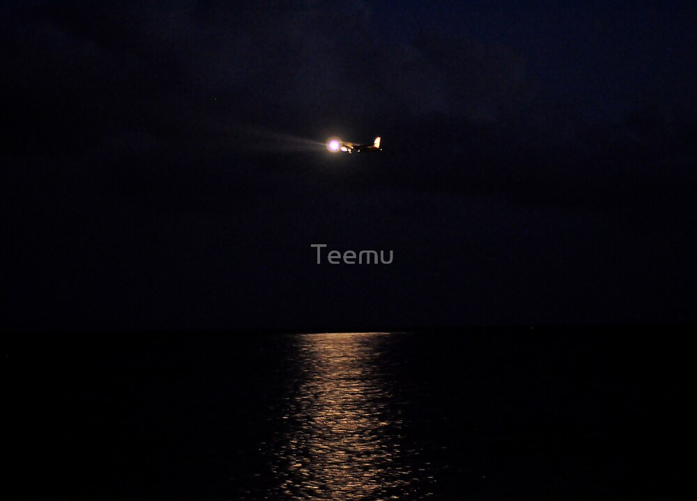 A plane in the night by Teemu