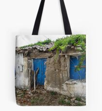 Fix a few slates and paint the door then it will be as good as new !! Tote Bag