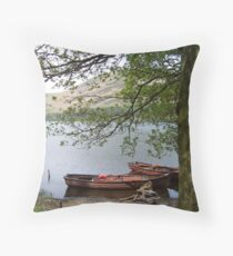Boats on a lake in Cumbria Throw Pillow