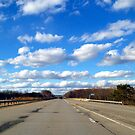 Fluffy Clouds from the road by rosincore