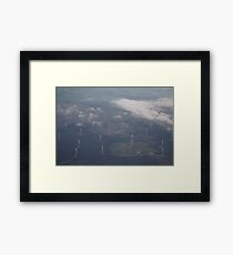Clouds above windmills below Framed Print