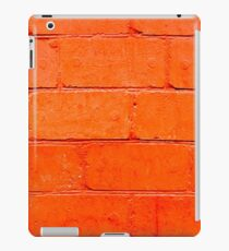 Red background of bricks with a layer of paint close-up iPad Case/Skin