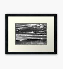 Family on storm beach Framed Print