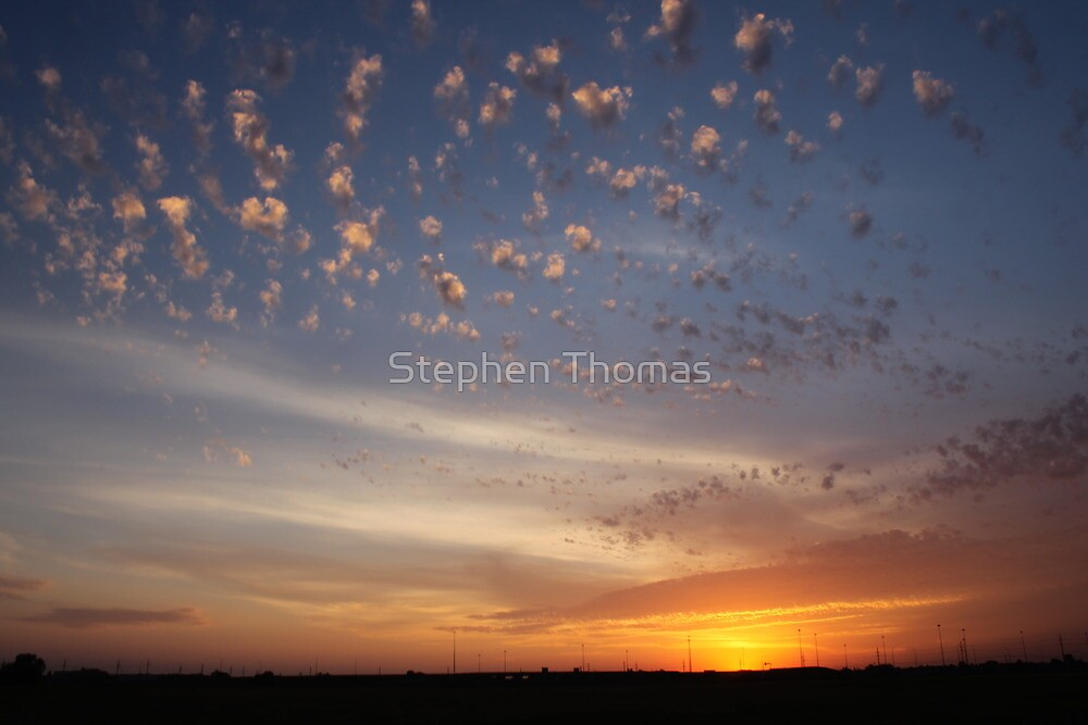 Sunset over overpass by Stephen Thomas