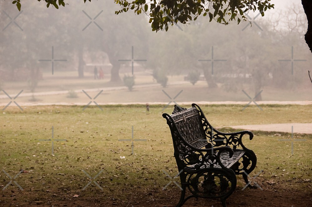 A wrought iron black metal bench under a tree in the Qutub Minar compound by ashishagarwal74
