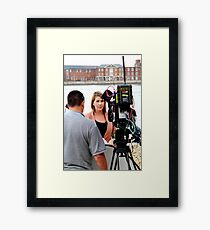 BBC news reporter on location Framed Print