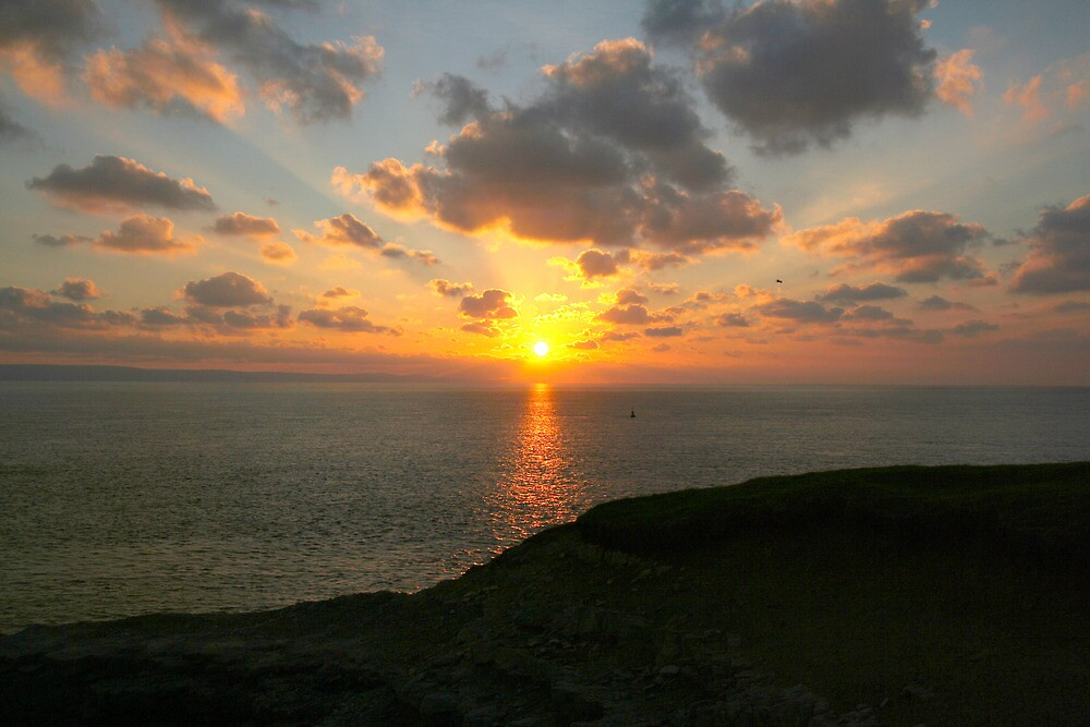 Sunset at Nash point 2 by Amanda Clegg