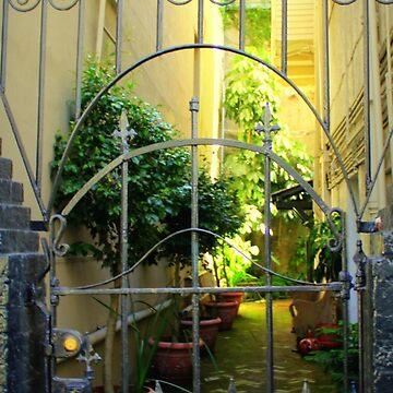 Peek Of New Orleans Courtyard Through Iron Gate by anitahiltz