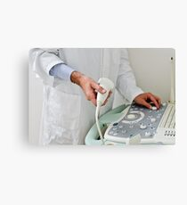 A doctor with echography equipment Canvas Print
