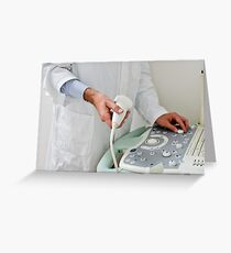 A doctor with echography equipment Greeting Card