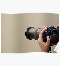 Using a zoom lens and a digital camera and reviewing the results on the LCD Poster