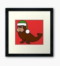 Christmas Walrus with Green Santa Hat Framed Print