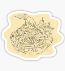 Hand holding basket full harvest crops Sticker