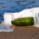 a bottle in the surf by Sue Downey