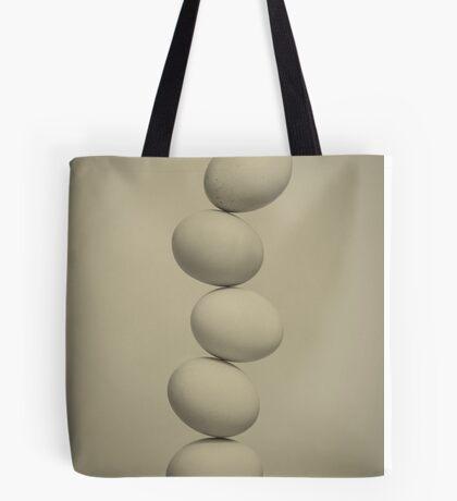 Balancing Eggs Tote Bag