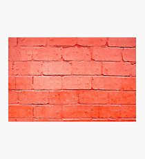 Red background of bricks with a layer of paint closeup Photographic Print