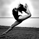 ballerina high back kick on the beach by thermosoflask