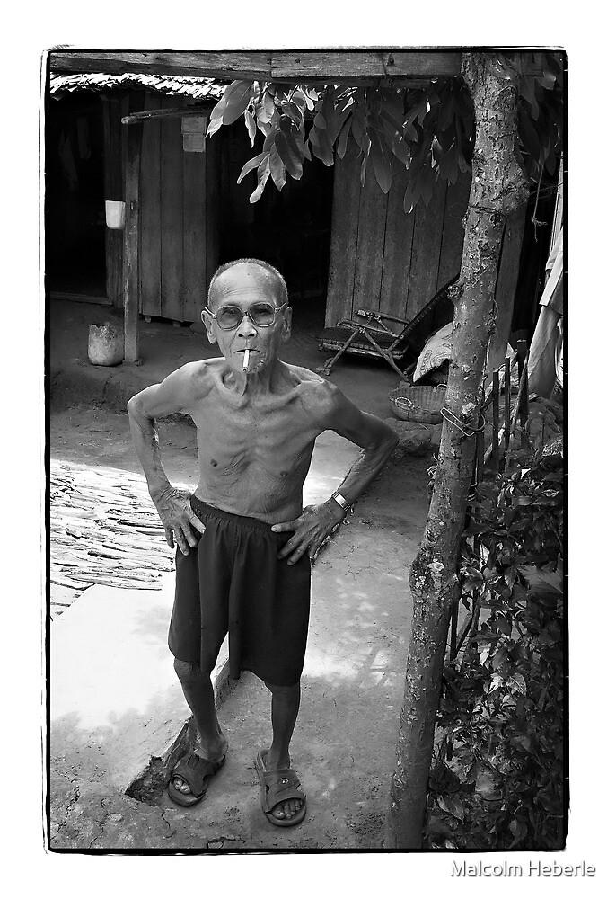 Local man Mekong Delta Vietnam by Malcolm Heberle