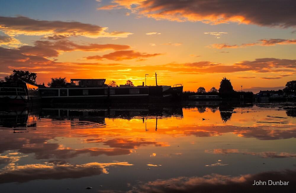 Sunrise arcross the water by John Dunbar