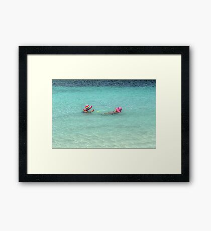 Enjoying the warm water in The Bahamas Framed Print