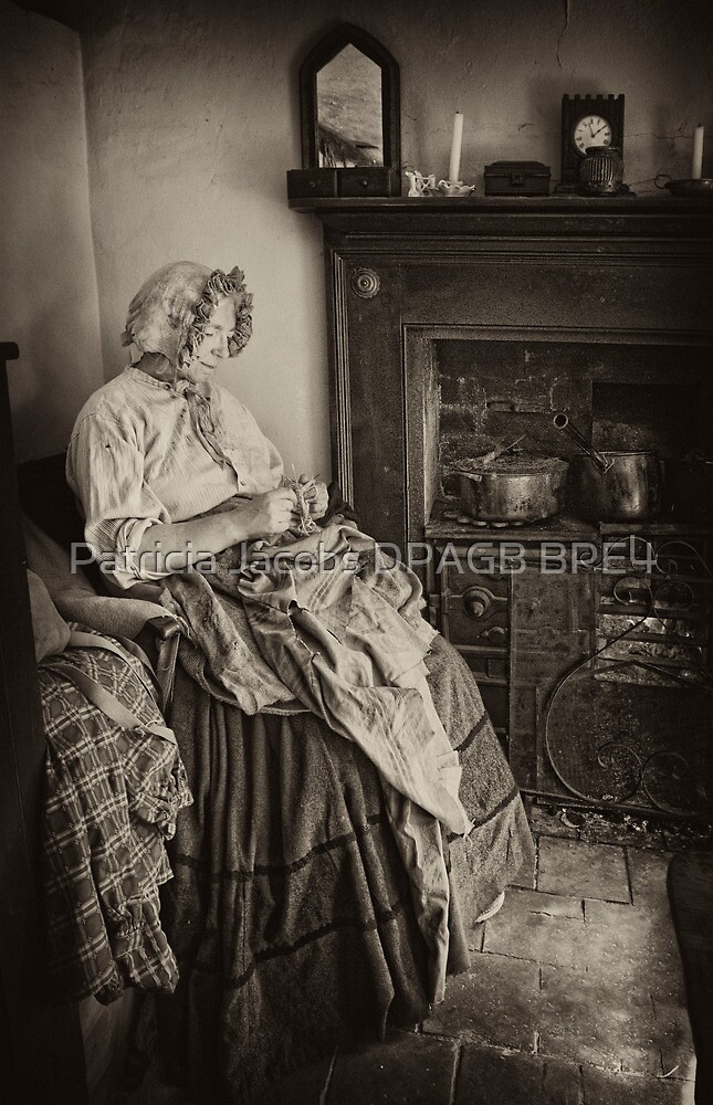 Darning by the fire by Patricia Jacobs DPAGB BPE4